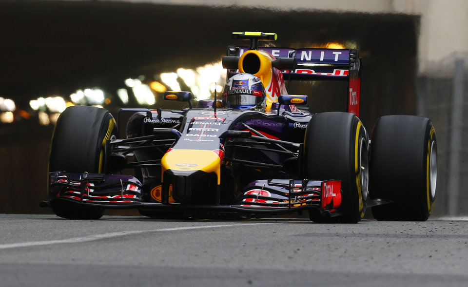 Photo - Red Bull driver Daniel Ricciardo of Australia steers his car during the first free practice at the Monaco racetrack, in Monaco, Thursday, May 22, 2013. The  Monaco Formula One Grand Prix will be held on Sunday. (AP Photo/Luca Bruno)