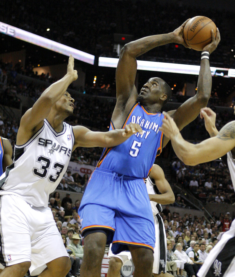 Photo - Oklahoma City's Kendrick Perkins (5) goes to the basket beside San Antonio's Boris Diaw during Game 1 of the Western Conference Finals between the Oklahoma City Thunder and the San Antonio Spurs in the NBA playoffs at the AT&T Center in San Antonio, Texas, Sunday, May 27, 2012. Photo by Bryan Terry, The Oklahoman