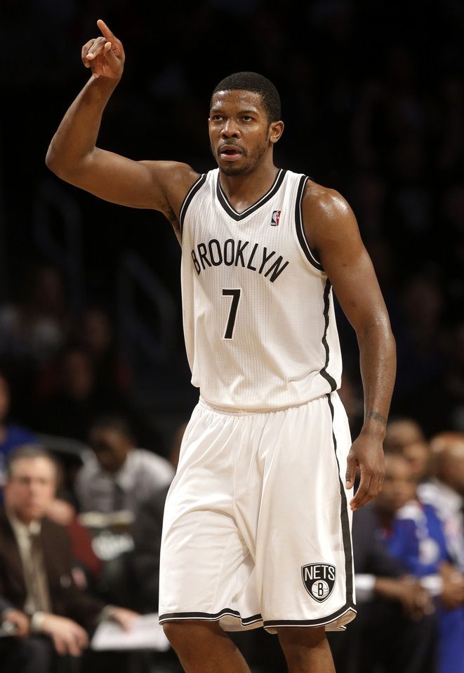 Photo - Brooklyn Nets' Joe Johnson reacts after hitting a three-point basket during the second half of the NBA basketball game at the Barclays Center Sunday, Dec. 23, 2012 in New York. The Nets beat the 76ers 95-92. (AP Photo/Seth Wenig)