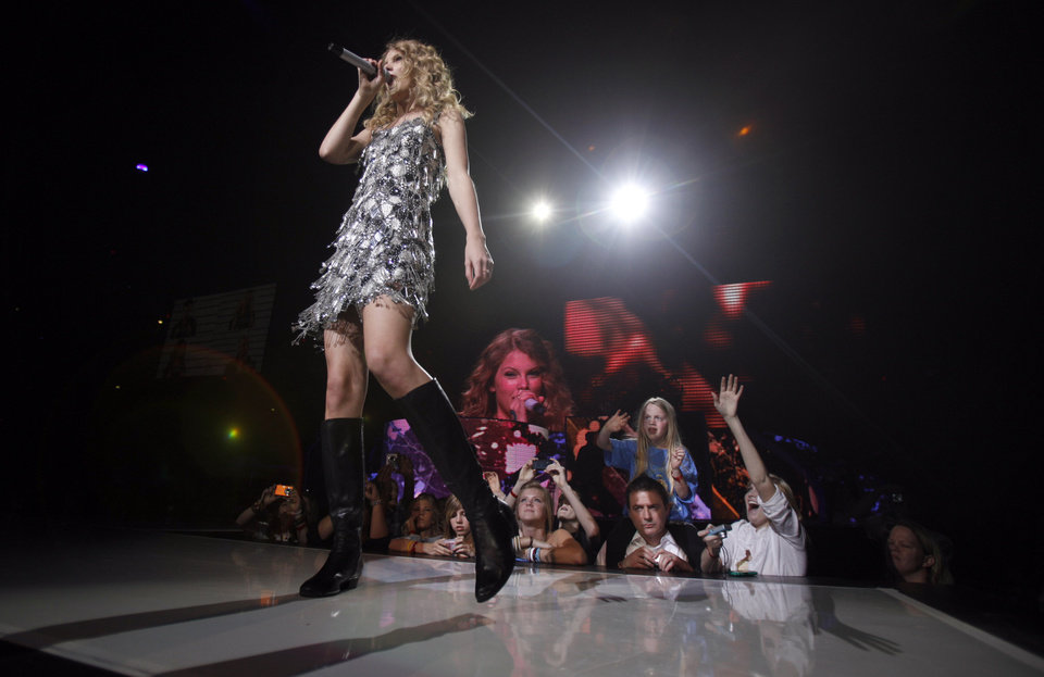Photo - Taylor Swift sings during the Fearless tour concert, Wednesday, March, 31, 2010, at the Ford Center in Oklahoma City. Photo by Sarah Phipps, The Oklahoman
