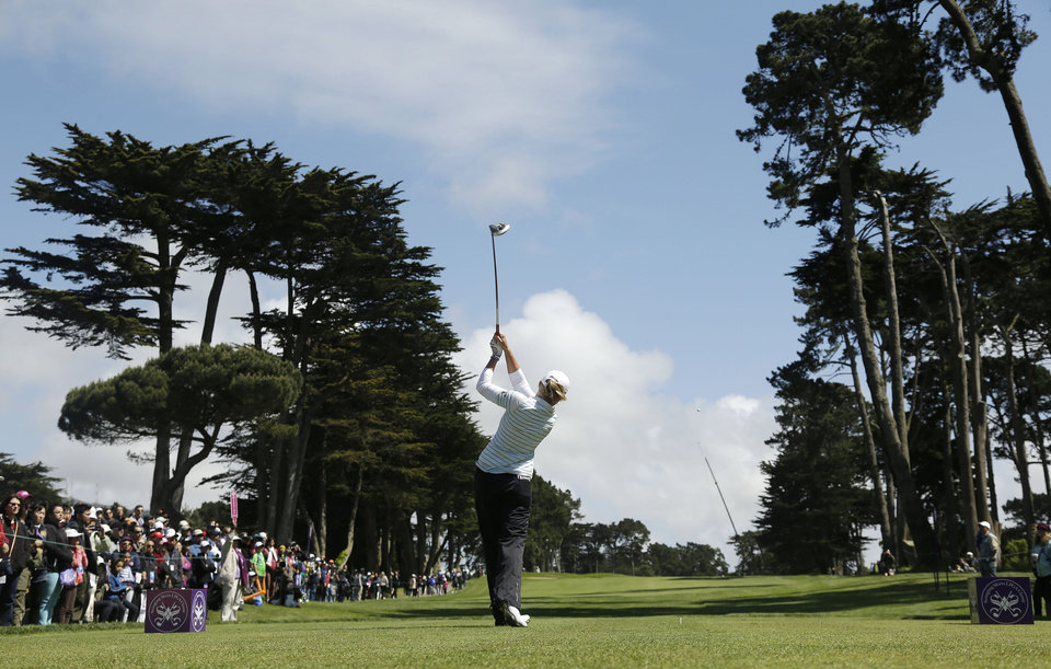 Photo - Stacy Lewis follows her drive from the sixth tee of Lake Merced Golf Club during the final round of the Swinging Skirts LPGA Classic golf tournament on Sunday, April 27, 2014, in Daly City, Calif. (AP Photo/Eric Risberg)