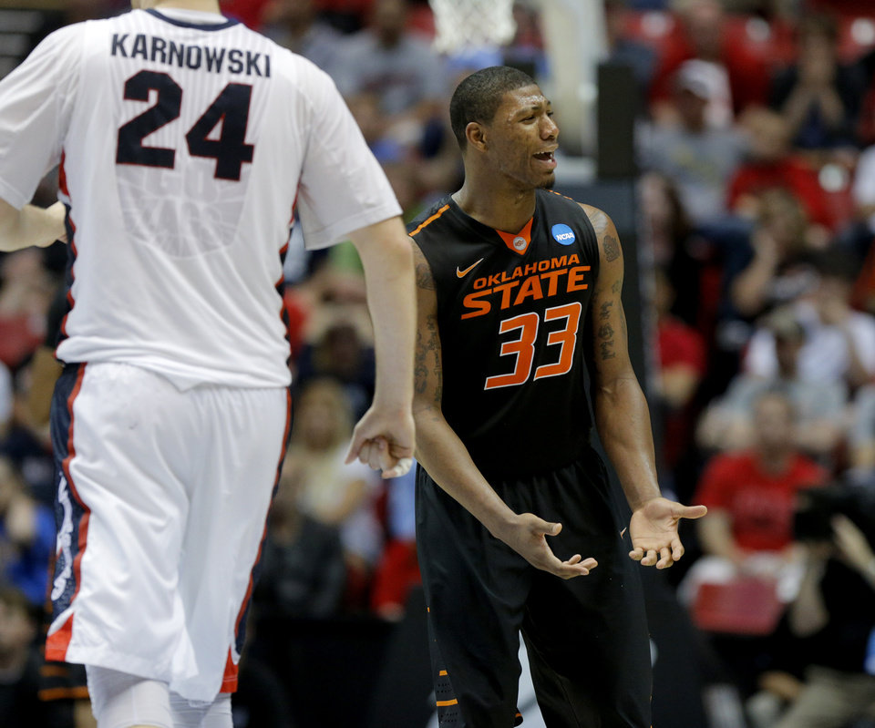 Photo - Oklahoma State's Marcus Smart (33) reacts during a second round game of the NCAA men's college basketball tournament at Viejas Arena in San Diego, between Oklahoma State and Gonzaga Friday, March 21, 2014. Gonzaga won 85-77. Photo by Bryan Terry, The Oklahoman