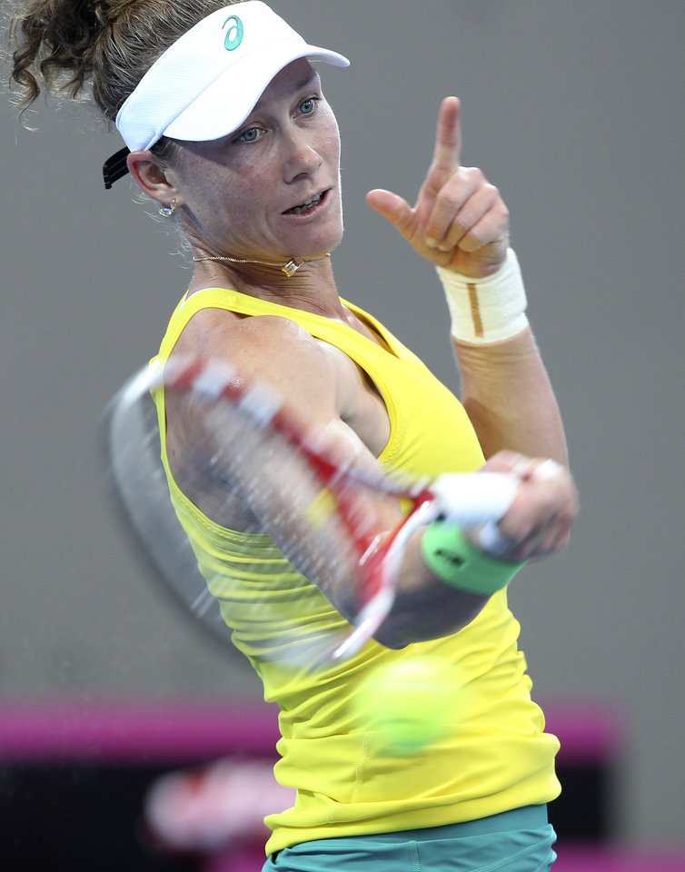 Photo - Samantha Stosur of Australia plays a shot during her match against Andrea Petkovic of Germany during the Fed Cup semifinals between Australia and Germany in Brisbane, Australia, Saturday, April 19, 2014. (AP Photo/Tertius Pickard)