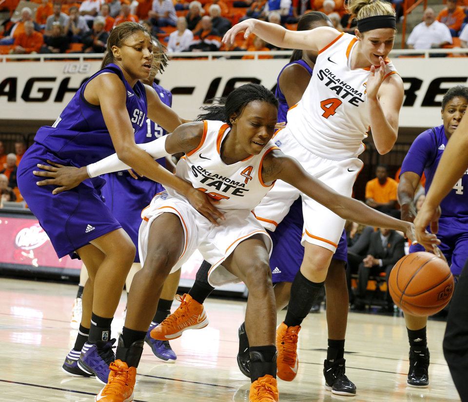 Oklahoma State's Toni Young (15) goes for the ball beside Stephen F. Austin's Tierany Henderson (31) as Oklahoma State's Liz Donohoe (4) watches during a women's college basketball game between Oklahoma State University and Stephen F. Austin at Gallagher-Iba Arena in Stillwater, Okla., Thursday, Dec. 6, 2012.  Photo by Bryan Terry, The Oklahoman
