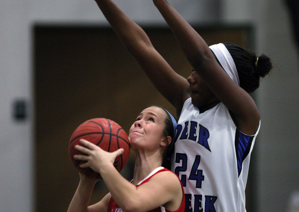 Photo - A Collinsville player (left) looks to shoot while defended by Edmond Deer Creek's Dakota Vann (24) during their first-round 5A girls state playoff matchup, in Catoosa, on Thursday, March 7, 2013. CORY YOUNG/Tulsa World