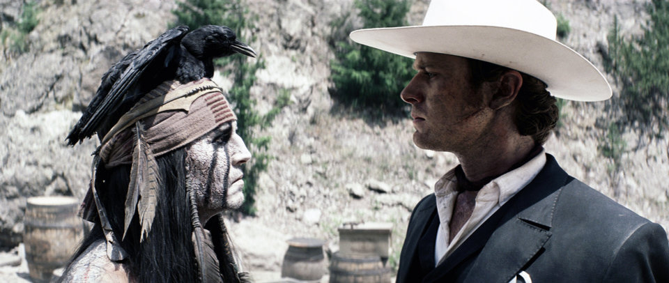 Photo - This film publicity image released by Disney shows Johnny Depp as Tonto, left, and Armie Hammer as The Lone Ranger, in a scene from