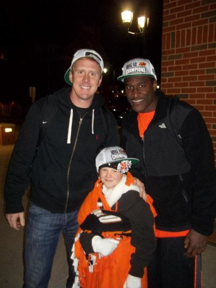 Photo - Olivia Hamilton, front, celebrates the Cowboys' Big 12 Championship with OSU quarterback Brandon Weeden and receiver Justin Blackmon. PHOTO PROVIDED