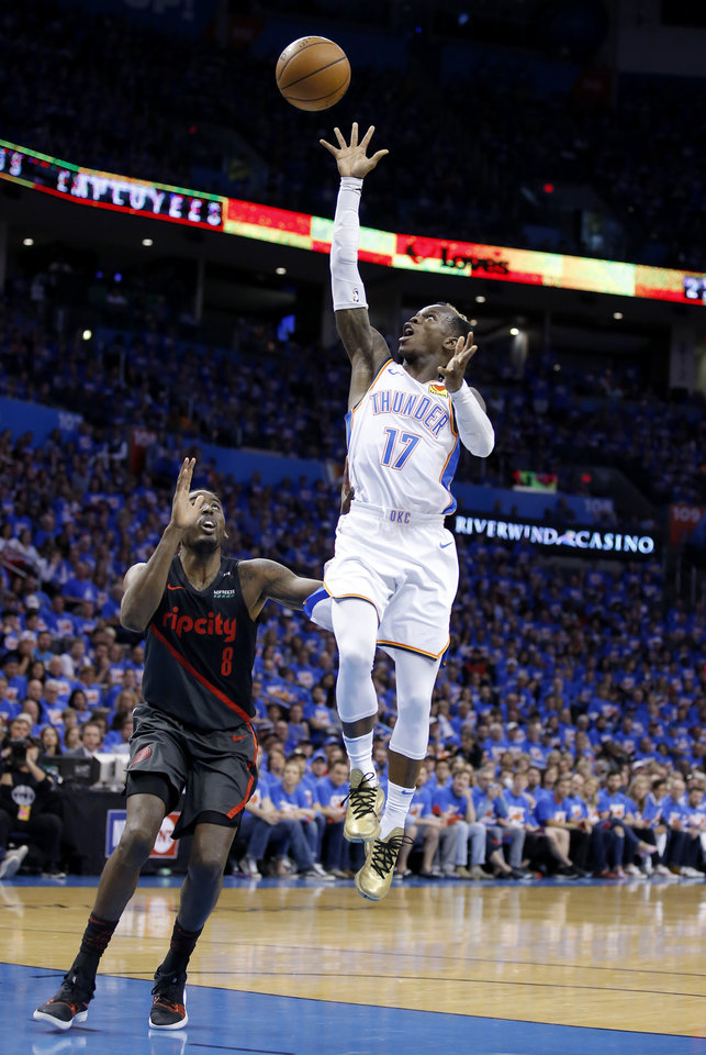 Photo - Oklahoma City's Dennis Schroder (17) shoots over Portland's Al-Farouq Aminu (8) during Game 4 in the first round of the NBA playoffs between the Portland Trail Blazers and the Oklahoma City Thunder at Chesapeake Energy Arena in Oklahoma City, Sunday, April 21, 2019. Portland won 111-98. Photo by Sarah Phipps, The Oklahoman