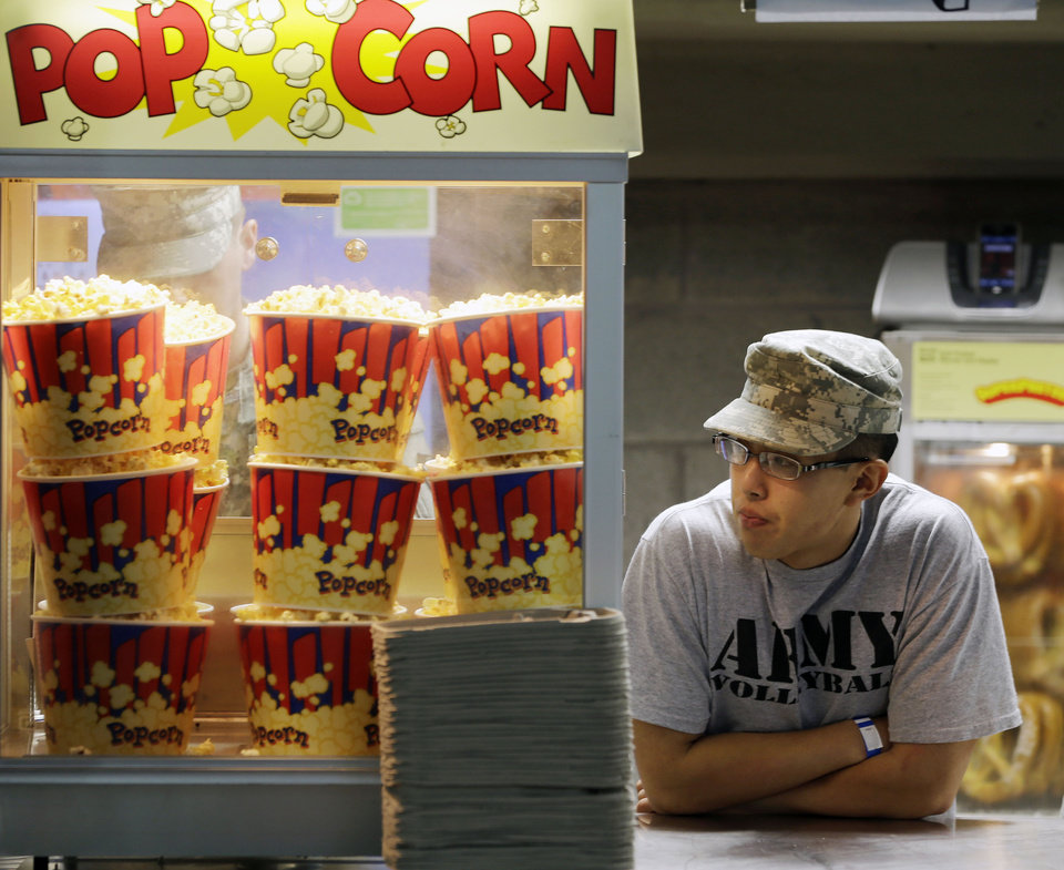 Photo -   Cadet Steven Liu of San Marino, Calif., waits for customers while working at a concession stand before an NCAA college football game between Army and Boston College on Saturday, Oct. 6, 2012, at Michie stadium in West Point, N.Y. (AP Photo/Mike Groll)