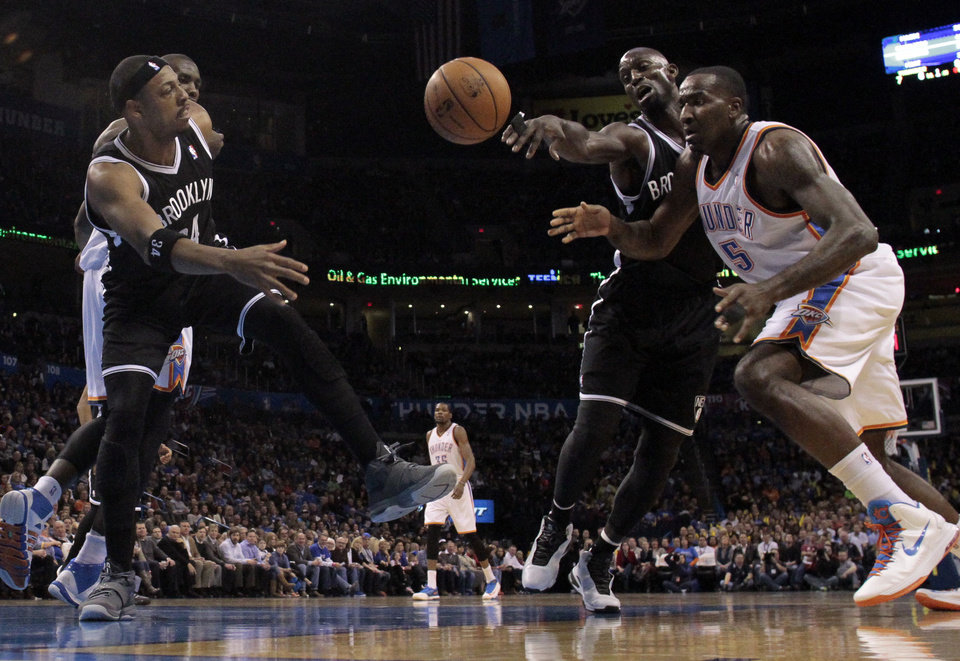 Photo - Thunder's Kendrick Perkins (5) has the ball knocked away by Brooklyn's Kevin Garnett in the first half of an NBA basketball game where the Oklahoma City Thunder were defeated 95-93 by the Brooklyn Nets at the Chesapeake Energy Arena in Oklahoma City, on Thursday, Jan. 2, 2014. Photo by Steve Sisney The Oklahoman