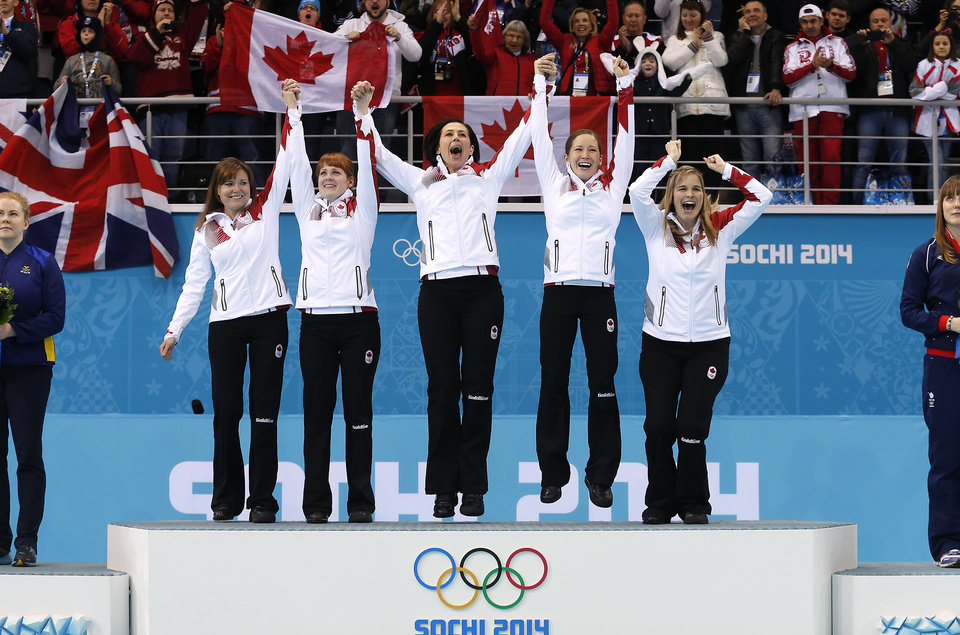 Photo - Canada's women's curling team as seen from left to right, Kirsten Wall, Dawn McEwen, Jill Officer, Kaitlyn Lawes and skip Jennifer Jones, celebrate during the flower ceremony after winning the women's curling gold medal game against Sweden at the 2014 Winter Olympics, Thursday, Feb. 20, 2014, in Sochi, Russia. (AP Photo/Wong Maye-E)