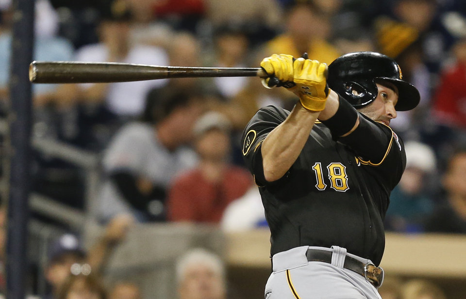 Photo - Pittsburgh Pirates' Neil Walker follows through with his swing that drilled a double to right and drove in two runs against the San Diego Padres during the seventh inning of a baseball game Monday, June 2, 2014, in San Diego. (AP Photo/Lenny Ignelzi)