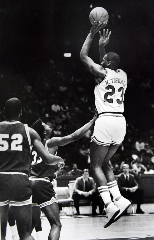 Photo - Former OU basketball player Wayman Tisdale. For Wayman Tisdale, it's that Magic Moment as he puts the ball up on a jumper that made him the Big Eight's all-time career scoring leader. Staff photo by George R. Wilson. Photo taken 1/12/1984, photo published 1/13/1984 in The Daily Oklahoman. ORG XMIT: KOD
