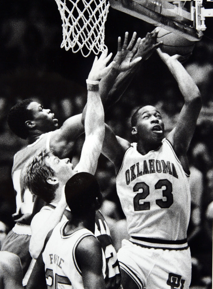 Former OU basketball player Wayman Tisdale. Wayman Tisdale beats the crowd to the hoop. Staff photo by Doug Hoke. Photo taken 2/20/1985, published 2/21/1985 in The Daily Oklahoman. ORG XMIT: KOD