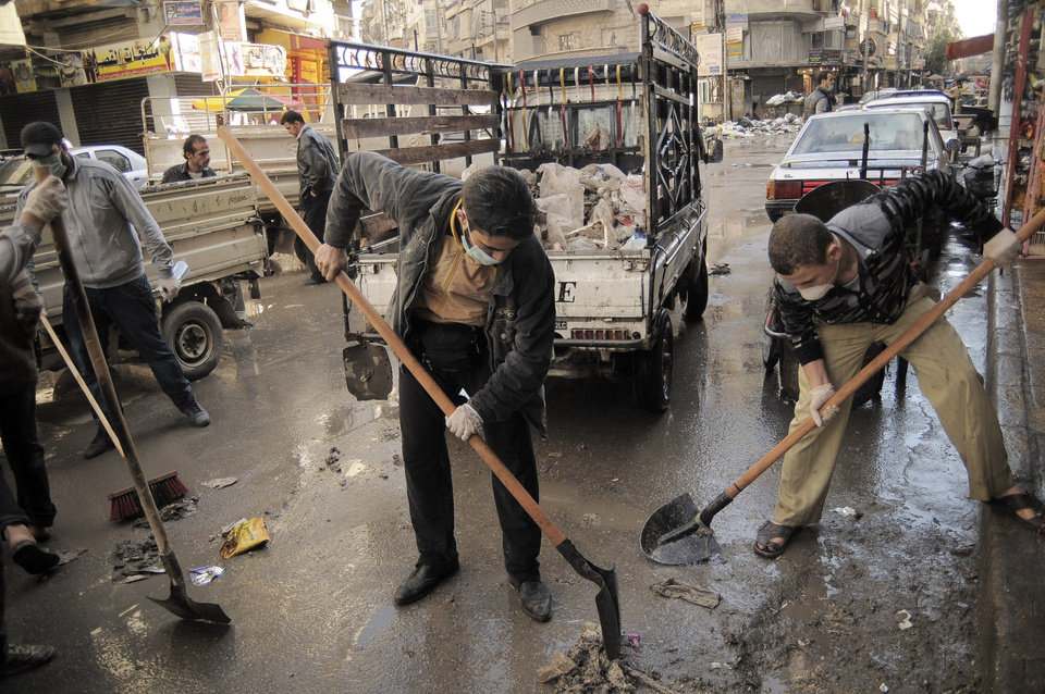 Photo -   In this Saturday, Nov. 10, 2012 photo, activists collect garbage from the streets of Aleppo, Syria. Three months after Free Syrian Army fighters brought the war to Aleppo, street cleaning and garbage pickup services collapsed because of fighting and shelling. (AP Photo/Mónica G. Prieto)