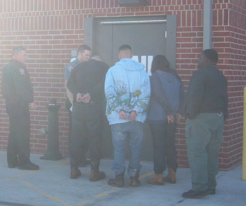 Photo - Three unidentified people are taken into custody Friday in Seminole County in connection with a methamphetamine trafficking ring. PHOTO PROVIDED BY OKLAHOMA BUREAU OF NARCOTICS AND DANGEROUS DRUGS CONTROL  Picasa