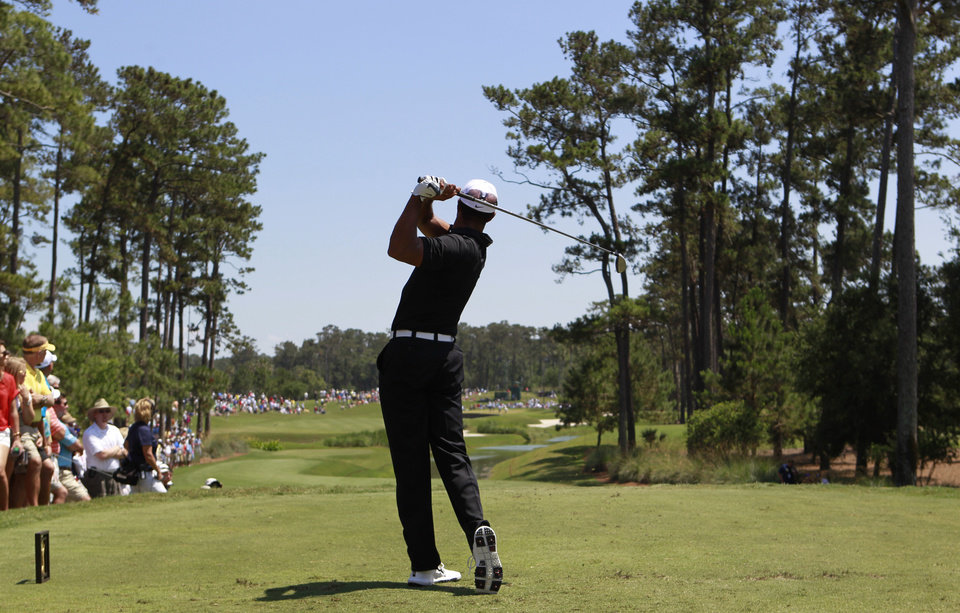 Photo -   Tiger Woods hits from the fourth tee during the second round of the Players Championship golf tournament at TPC Sawgrass, Friday, May 11, 2012, in Ponte Vedra Beach, Fla. (AP Photo/John Raoux)