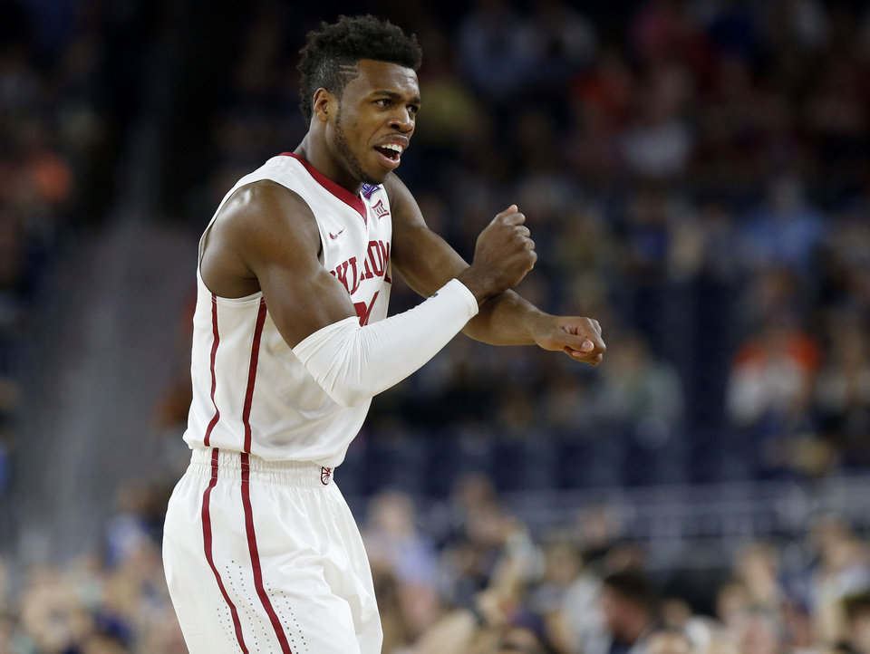 Photo - Oklahoma's Buddy Hield (24) reacts to a no call during the national semifinal between the Oklahoma Sooners (OU) and the Villanova Wildcats in the Final Four of the NCAA Men's Basketball Championship at NRG Stadium in Houston, Saturday, April 2, 2016. Photo by Nate Billings, The Oklahoman