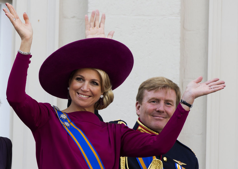 FILE - In his Sept. 18, 1012 file photo Princess Maxima, left, and Crown Prince Willem Alexander, wave to well wishers from the balcony of Royal Palace Noordeinde in The Hague, Netherlands. Prince Willem-Alexander�s ascension to the Dutch throne in April 2013 promises to be a shining moment on the world stage for his wife Maxima and her home country of Argentina. But there will be a glaring absence at the ceremony. Queen Beatrix�s announcement this week that she�ll step aside and let her son become king raised new questions about the future queen�s father, Jorge Zorreguieta, one of the longest-serving civilian ministers in Argentina�s 1976-1983 military dictatorship.(AP Photo/Vincent Jannink, file)