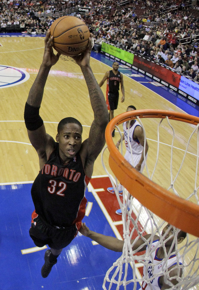 Photo - FILE - In this Jan. 18, 2013, file photo, Toronto Raptors' Ed Davis soars to the basket during an NBA basketball game against the Philadelphia 76ers in Philadelphia. A person with knowledge of the deal tells The Associated Press the Memphis Grizzlies have agreed to trade swingman Rudy Gay to the Raptors. The Raptors gave up point guard Jose Calderon in the deal, though it appears he is headed to a third team other than the Grizzlies, the person said. Davis was also part of the deal. The person spoke on the condition of anonymity because the deal had not yet been announced.(AP Photo/Matt Slocum, File)