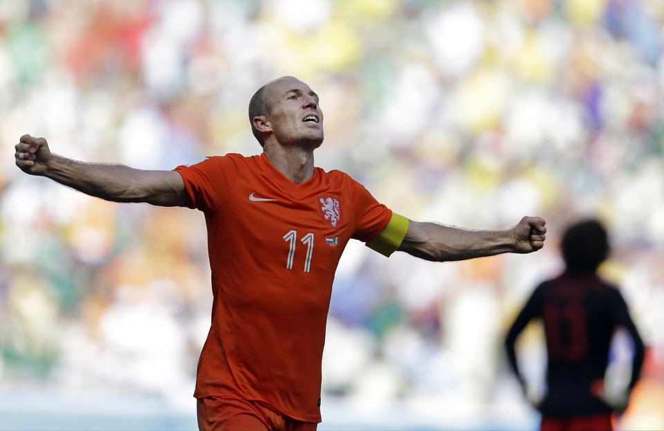Photo - Netherlands' Arjen Robben celebrates after the World Cup round of 16 soccer match between the Netherlands and Mexico at the Arena Castelao in Fortaleza, Brazil, Sunday, June 29, 2014. The Netherlands won the match 2-1. (AP Photo/Natacha Pisarenko)