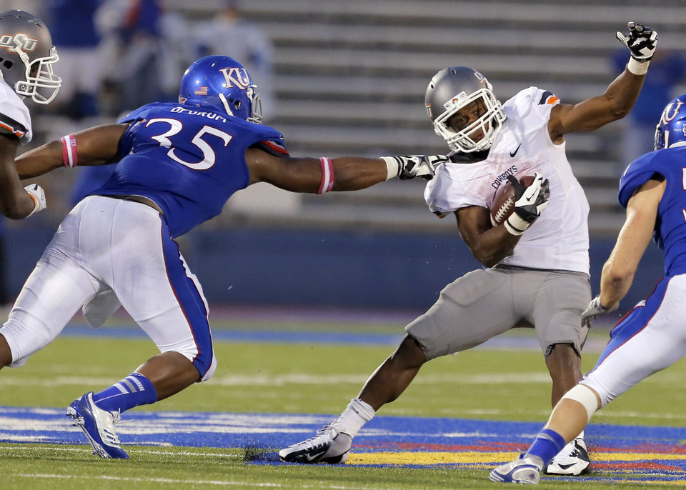 Oklahoma State's Joseph Randle (1) is brought down by Kansas' Toben Opurum (35) during the college football game between Oklahoma State University (OSU) and the University of Kansas (KU) at Memorial Stadium in Lawrence, Kan., Saturday, Oct. 13, 2012. Photo by Sarah Phipps, The Oklahoman