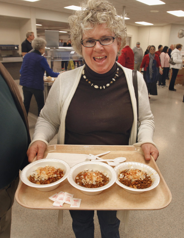 Connie Jensen gets chili for herself and two friends at the annual Police and Firemen's Benefit Chili Supper on Thursday, Jan. 12, 2012, in Norman, Okla.   Photo by Steve Sisney, The Oklahoman