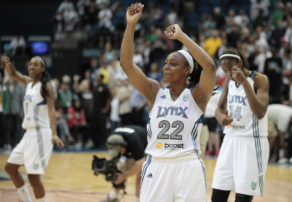 Photo - Minnesota Lynx guard Monica Wright (22) celebrates with teammates after their 105-83 win against the Phoenix Mercury in an WNBA basketball game, Sunday, May 20, 2012, in Minneapolis. (AP Photo/Stacy Bengs)