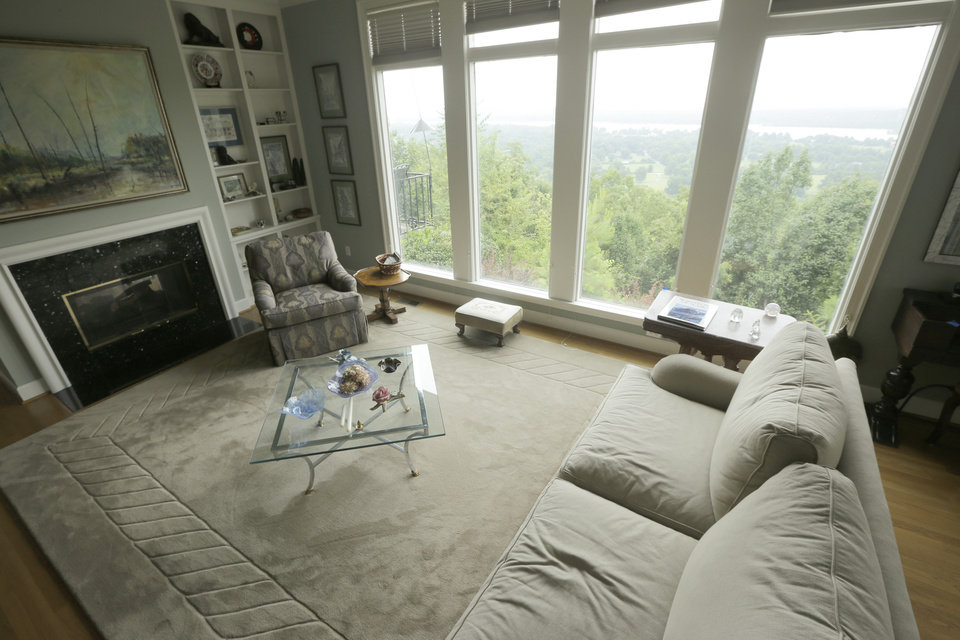 Photo - This is an interior view of the living room at a home for sale listed at $999,500 that is located on 5 acres of land overlooking the Arkansas River valley on Wednesday, July 30, 2014, in Little Rock, Ark. (AP Photo/Danny Johnston)