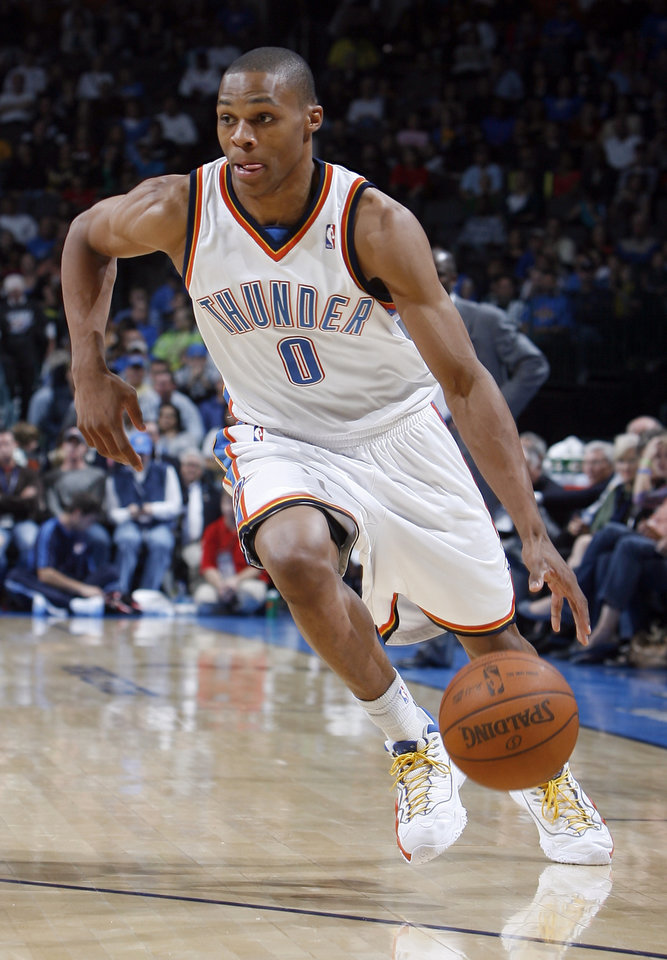 Photo - Oklahoma City's Russell Westbrook (0) drives toward the basket during the NBA game between the Oklahoma City Thunder and the Portland Trail Blazers, Sunday, Nov. 1, 2009, at the Ford Center in Oklahoma City. Photo by Sarah Phipps, The Oklahoman