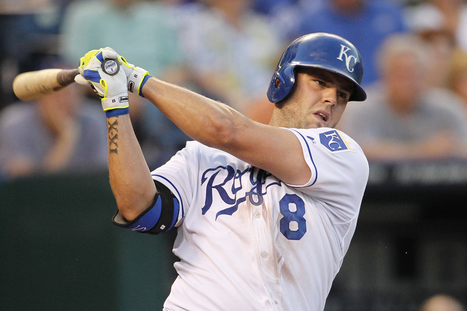 Photo - Kansas City Royals'  Mike Moustakas hits an RBI double in the fourth inning of a baseball game against the the Los Angeles Dodgers at Kauffman Stadium in Kansas City, Mo., Wednesday, June 25, 2014. (AP Photo/Colin E. Braley)