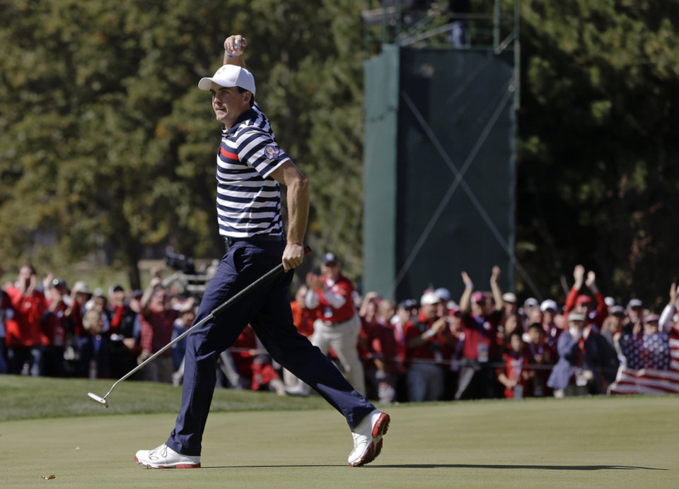 Photo - USA's Keegan Bradley reacts after making a birdie putt on the 11th hole during a singles match at the Ryder Cup PGA golf tournament Sunday, Sept. 30, 2012, at the Medinah Country Club in Medinah, Ill. (AP Photo/Chris Carlson)  ORG XMIT: PGA137