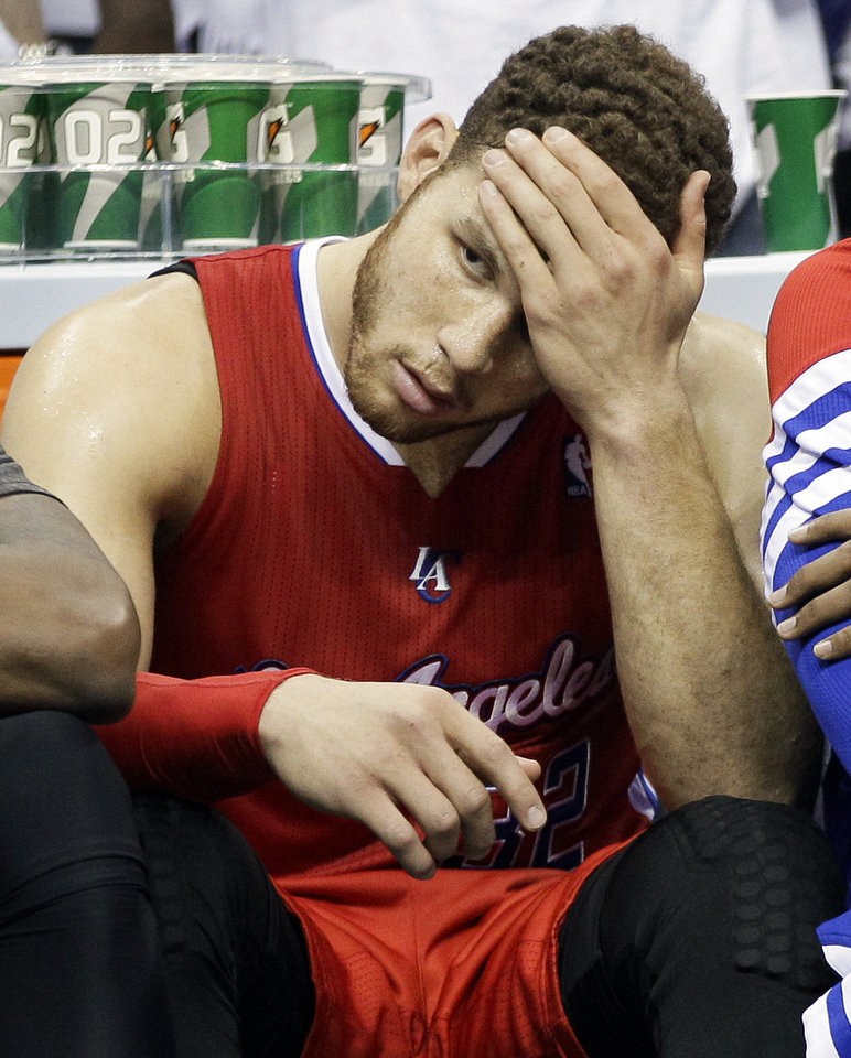 Photo -   Los Angeles Clippers forward Blake Griffin sits on the bench in the closing moments of the second half of Game 5 against the Memphis Grizzlies in a first-round NBA basketball playoff series on Thursday, May 10, 2012, in Memphis, Tenn. The Grizzlies won 92-80. (AP Photo/Mark Humphrey)