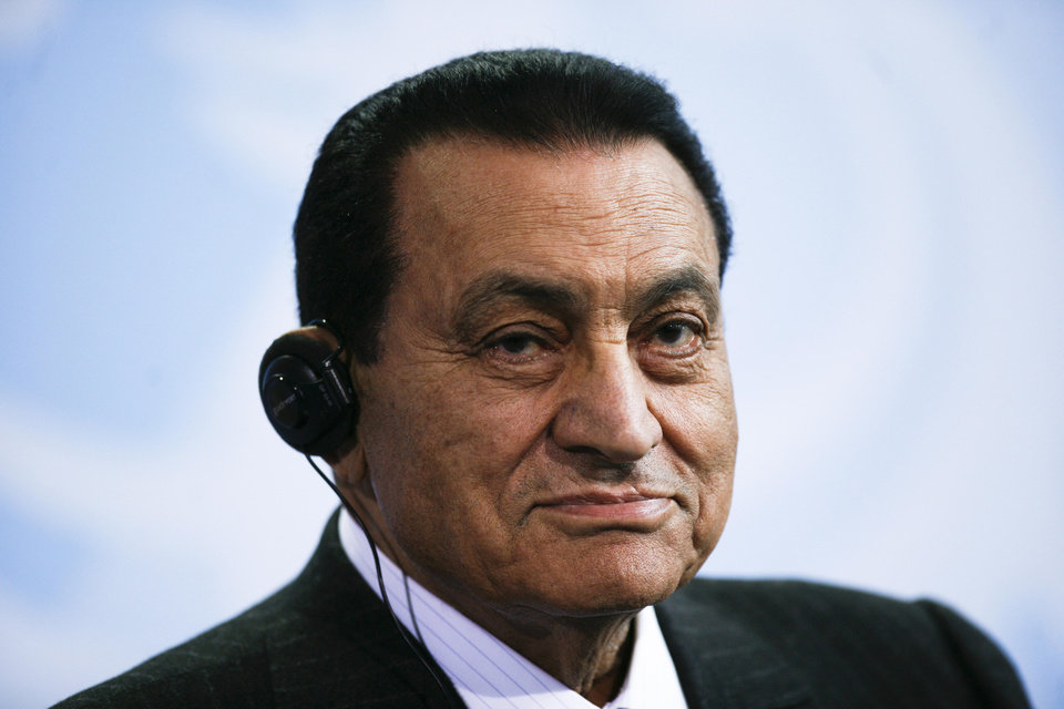 Photo - FILE - In this Thursday, March 4, 2010 file photo, Egyptian President Hosni Mubarak addresses the media after a meeting with German Chancellor Angela Merkel, not pictured, at the chancellery in Berlin, Germany. Officials say an Egyptian court has ordered the release of ex-President Mubarak, but it's not immediately clear whether the prosecutors will appeal the order. (AP Photo/Markus Schreiber, File)