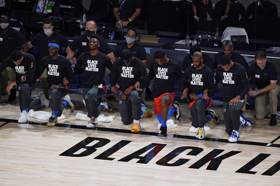 Photo - Aug 1, 2020; Lake Buena Vista, FL, USA; Players kneel before an NBA basketball game  between the Utah Jazz and Oklahoma City Thunder, Saturday, Aug. 1, 2020, in Lake Buena Vista, Fla. Mandatory Credit: Ashley Landis/Pool Photo via USA TODAY Sports