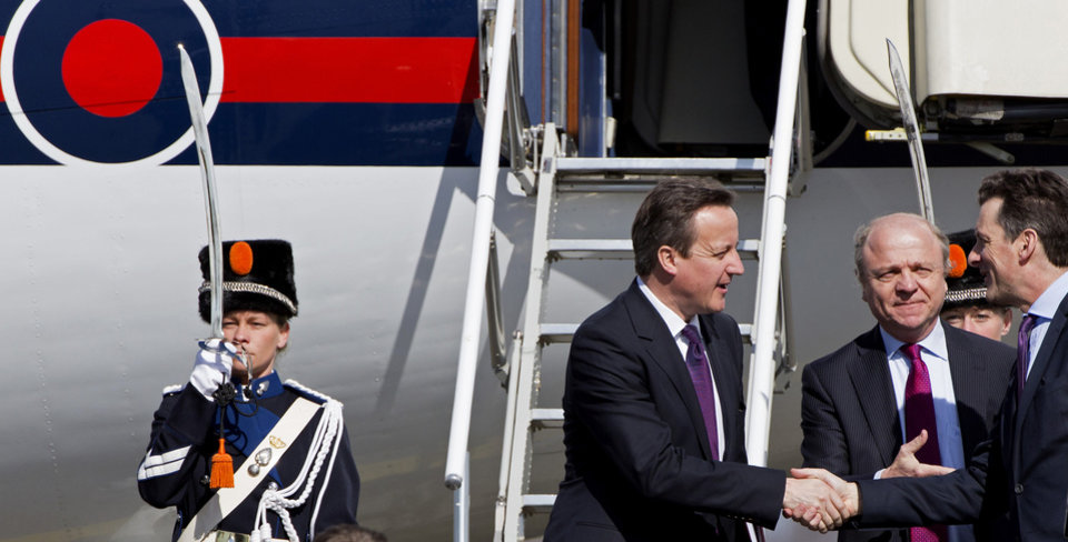 Photo - British Prime Minister David Cameron, center, arrives at Schiphol airport in Amsterdam on Monday March 24, 2014 ahead of the March 24-25 Nuclear Security Summit (NSS) in The Hague. (AP Photo/Martijn Beekman, POOL)