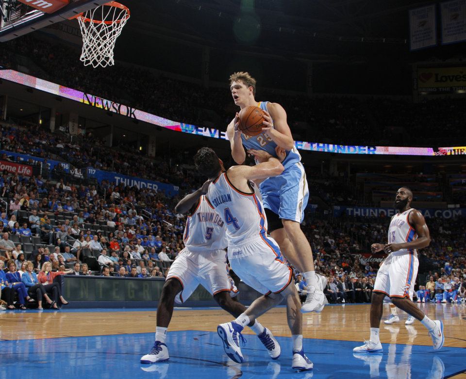 Denver's Timofey Mozgov (25) comes down on Oklahoma City's Nick Collison (4) during the NBA preseason basketball game between the Oklahoma City Thunder and the Denver Nuggets at the Chesapeake Energy Arena, Sunday, Oct. 21, 2012. Photo by Garett Fisbeck, The Oklahoman