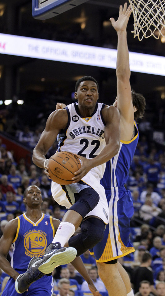 Photo -   Memphis Grizzlies' Rudy Gay (22) drives for a shot against Golden State Warriors' Andrew Bogut during the first half of an NBA basketball game Friday, Nov. 2, 2012, in Oakland, Calif. (AP Photo/Ben Margot)