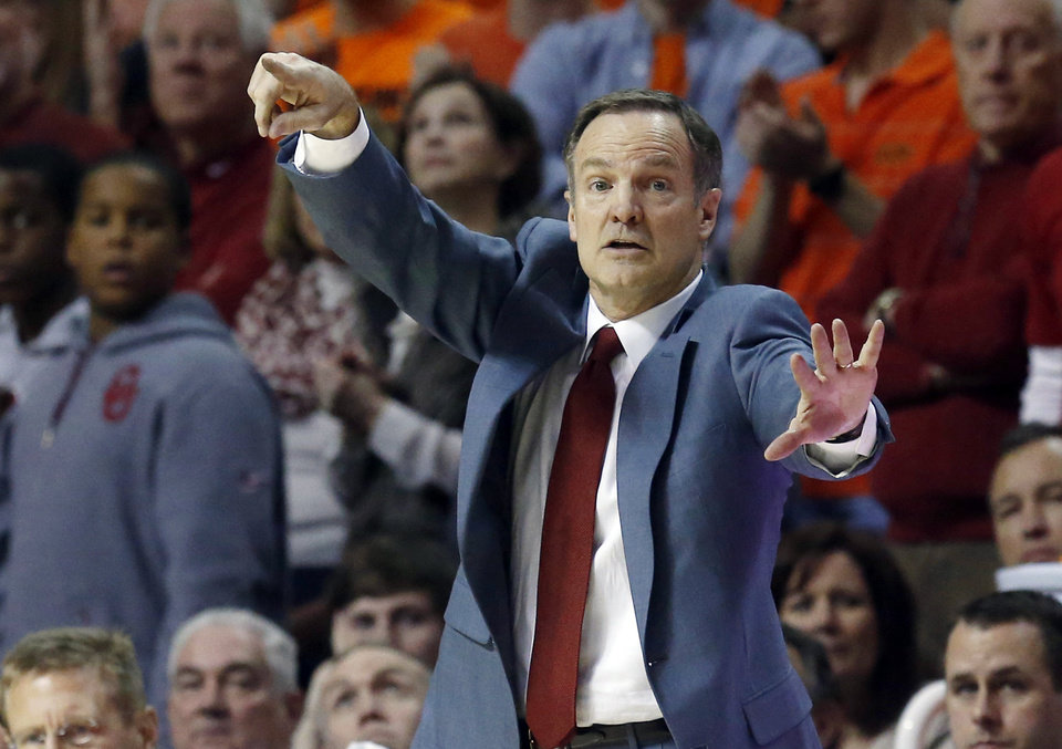 Photo - Oklahoma head coach Lon Kruger directs his team in the second half of an NCAA college basketball game against Oklahoma State in Stillwater, Okla., Saturday, Feb. 15, 2014. Oklahoma won 77-74. (AP Photo/Sue Ogrocki)