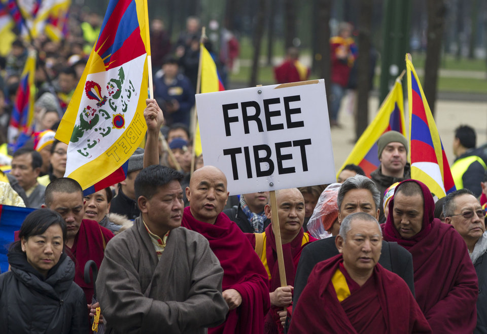 Chief Abbot of the Kirti Monastery, Kyabje Kirti Rinpoche, fourth right, leads a march of Tibetans and their supporters during a demonstration in Brussels on Sunday, March 10, 2013. The Europe-wide rally by Tibetans and Tibet supporters was held in Brussels on Sunday to mark the 54th anniversary of Tibet's national uprising. (AP Photo/Virginia Mayo)
