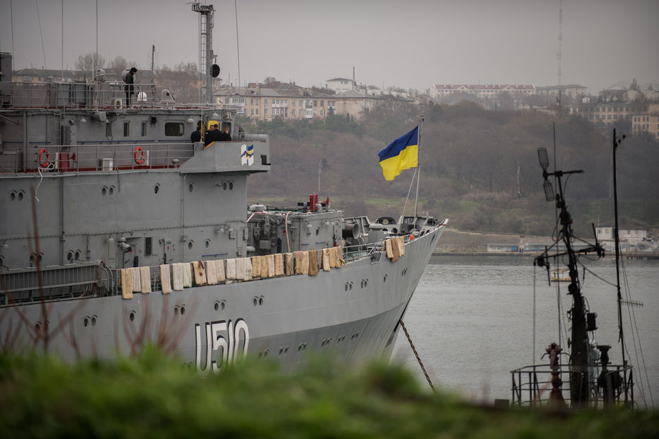 Photo - A Ukrainian national flag flies on the board of  Ukrainian navy ship Slavutich, at harbor of  in Sevastopol, Ukraine, Tuesday, March 4, 2014. Crimea still remained a potential flashpoint. Pro-Russian troops who had taken control of the Belbek air base in Crimea fired warning shots into the air Tuesday as around 300 Ukrainian soldiers, who previously manned the airfield, demanded their jobs back.(AP Photo/Andrew Lubimov)