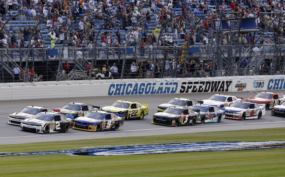 Photo - Brian Scott (2) leads the field at the start of the NASCAR Nationwide series auto race at Chicagoland Speedway in Joliet, Ill., Saturday, July 19, 2014. (AP Photo/Nam Y. Huh)