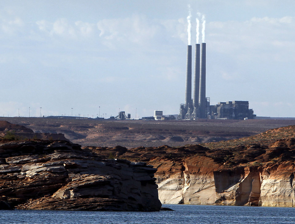 Photo - FILE - In this Sept. 4, 2011 file photo shows the main plant facility at the Navajo Generating Station, from Lake Powell, in Page, Ariz. The United Nations climate chief is urging people not to look solely to their governments to make tough decisions to slow global warming, and instead to consider their own role in solving the problem. Approaching the half-way point of two-week climate talks in Doha, Christiana Figueres, the head of the U.N.'s climate change secretariat, said Friday, Nov. 30, 2012 that she didn't see