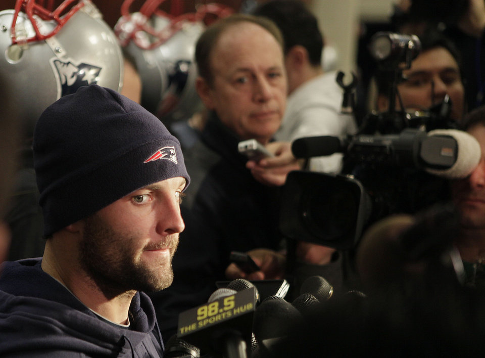 Photo - New England Patriots wide receiver Wes Welker (83) listens to a reporter's question during a media availability in front of his locker at the NFL football team's facility in Foxborough, Mass., Wednesday morning, Dec. 16, 2009. (AP Photo/Stephan Savoia) ORG XMIT: MASS107