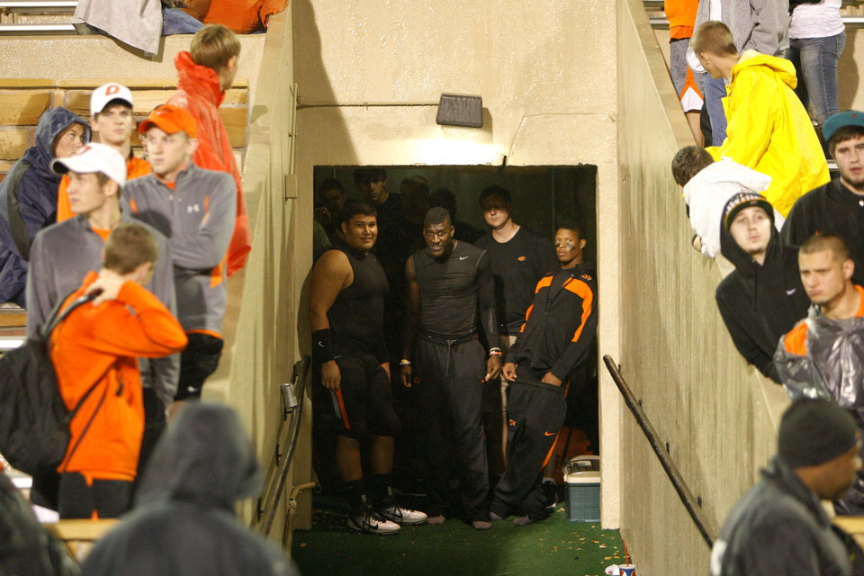 Photo - Oklahoma State's' Justin Blackmon (81)looks at the weather during a rain delay at a college football game between the Oklahoma State University Cowboys  and the University of Tulsa Golden Hurricane at H.A. Chapman Stadium in Tulsa, Okla., Saturday, Sept. 17, 2011. Photo by Sarah Phipps, The Oklahoman