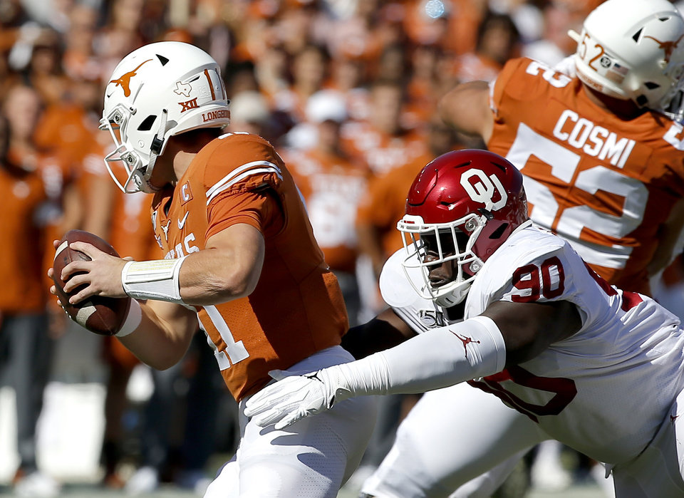 Photo - Oklahoma's Neville Gallimore (90) sacks Texas quarterback Sam Ehlinger (11) in the first quarter during the Red River Showdown college football game between the University of Oklahoma Sooners (OU) and the Texas Longhorns (UT) at Cotton Bowl Stadium in Dallas, Saturday, Oct. 12, 2019. [Sarah Phipps/The Oklahoman]