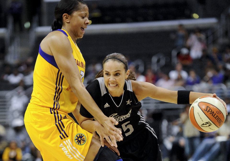 Photo - FILE - In this Sept. 6, 2011 file photo, San Antonio Silver Stars guard Becky Hammon, right, drives on Los Angeles Sparks forward Candace Parker, left, as she moves to the basket in the first half of a WNBA basketball game in Los Angeles. Stars guard and 16-year WNBA veteran Becky Hammon will retire at the conclusion of the 2014 WNBA season, the team announced Wednesday, July 23, 2014. (AP Photo/Gus Ruelas, File)
