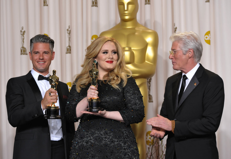 Photo - Adele and Paul Epworth pose with their award for best original song for