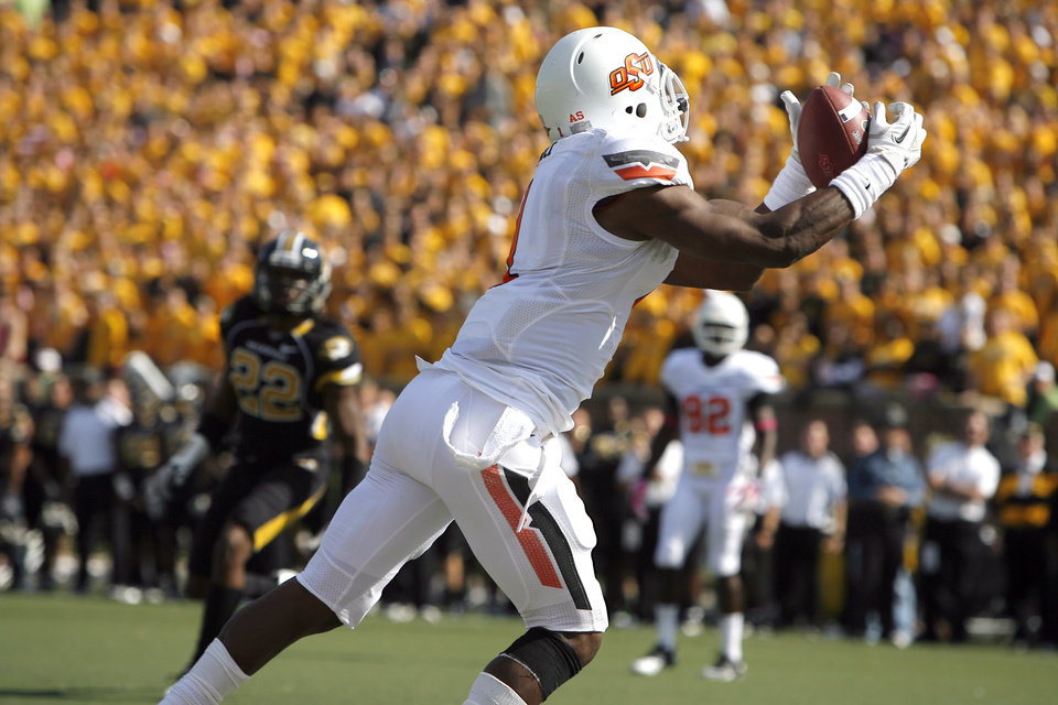 Photo - Oklahoma State's Joseph Randle (1) scores a touchdown during a college football game between the Oklahoma State University Cowboys (OSU) and the University of Missouri Tigers (Mizzou) at Faurot Field in Columbia, Mo., Saturday, Oct. 22, 2011. Photo by Sarah Phipps, The Oklahoman