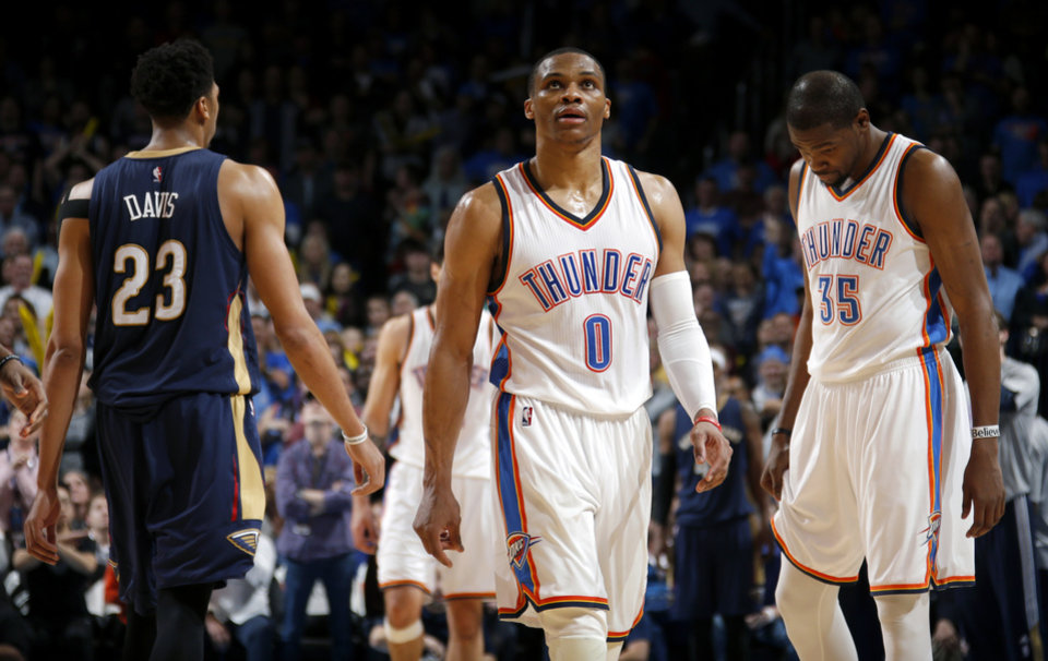Photo - Oklahoma City's Russell Westbrook (0) and Kevin Durant (35) react during an NBA game between the Oklahoma City Thunder and the New Orleans Pelicans at Chesapeake Energy Arena on Friday, Feb. 6, 2015. Photo by Bryan Terry, The Oklahoman